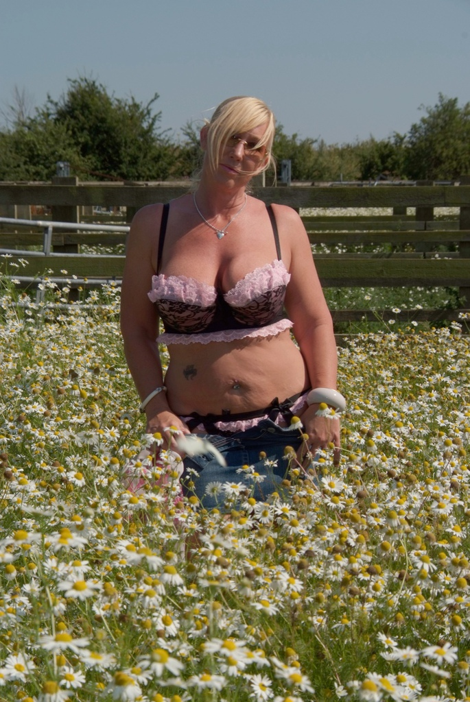 Stripping in the meadow and unleashing her FF tits